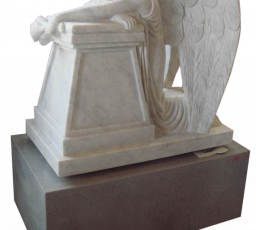 Weeping sculpted  angel on large pedestal